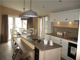 Stunning Luxury Lodge, large glass wrap round deck, 12 month park - North Yorkshire
