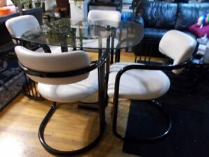 Glass table and 4 white chairs, black tubular steel