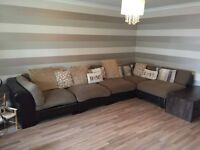 Large brown fabric corner sofa/suite/couch with matching pouffe