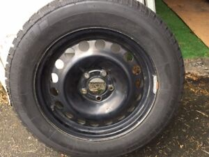 215/60R16 95T Uniroyal Tiger Paw Snow Tires mounted on Rims