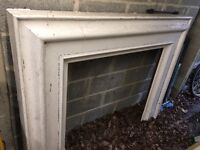 Fireplace surround in painted hard wood, 167cms wide by 120cms high