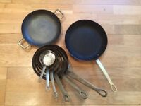 Set of used copper pans