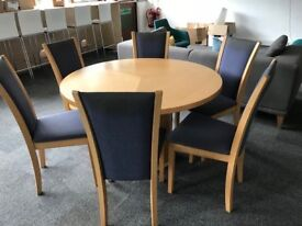Round meeting room table with six matching chairs. Beech veneer finish. 120cm diameter.