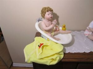 Four Ashton Drake Porcelain Dolls