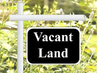 Vacant land approved for building 5 town houses.