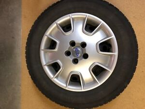 Four winter tires, wheels and Volvo hubcaps 215/65R 16