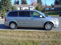 2015 Town Country a step above Grand Caravan only 12,300 kms