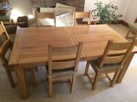 Light oak extendable dining table and 8 chairs