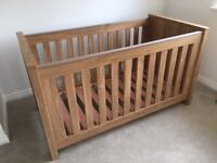 Baby Style Bordeaux cot bed and dresser with changing unit attached.