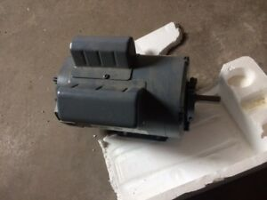 2 Motors - one new never used, second used a few years
