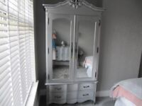 Set of Brand New silver bedroom draws and Wardrobe to match.