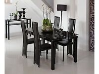 noir table and 4 upholstered chairs
