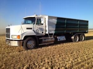 Mack with grain,silage and flat deck