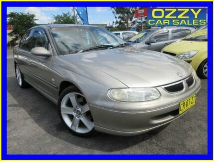 1999 Holden Berlina Vtii Champagne 4 Speed Automatic Sedan Minto Campbelltown Area Preview