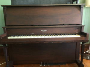 Free upright Piano .. In tune.