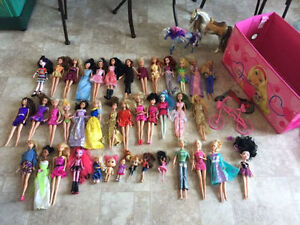 Doll house, 40 barbies, 8 DVDs, organizer, horses...more