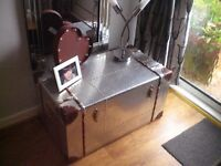 silver and leather chest