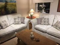 Two Ivory Damask Double Sofas