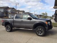 """2010 Ford F-150 FX4 lifted and 35"""" tires. Stands out!"""