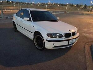 STOLEN: 2004 White BMW 320i
