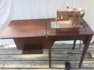 Singer 328J sewing machine in cabinet