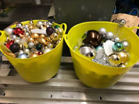 2 large buckets of Christmas decorations.