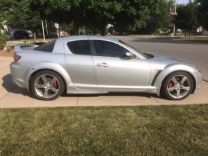 High mileage RX8 sports car with +$4000 aftermarket upgrades