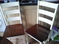 Four Solid Wood Kitchen Chairs . Bargain £80.00.Ready to go.