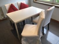 Dining Table and 4 Ikea Hendriksdal Chairs with 4 long & 4 short chair covers. Price negotiable