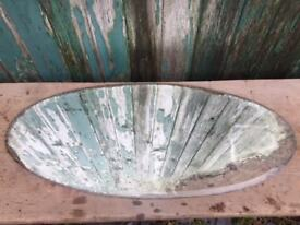 Salvaged distressed oval mirror glass
