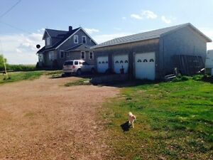 4 BDRM House and 3 car garage on acreage