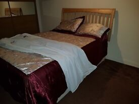Double bed with orthapedic matress and solid oak head board