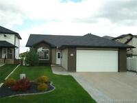 2 + 2 BEDROOM WALK-OUT BUNGALOW & BACKS ONTO GREEN SPACE!
