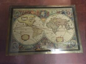 Two antique wooden and brass coffe tables depicting historic world maps