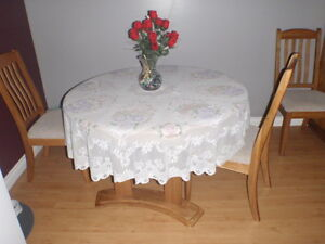 like new hardwood round table with inset and 4 chairs