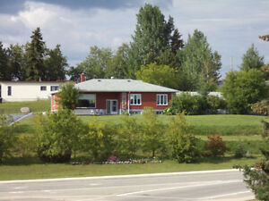 Cochrane Bungalow with Income Apartment