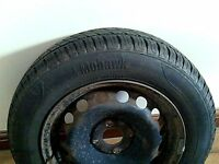 New tyre on a wheel from a Fiat Punto - size 165/70 R14