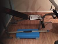 Weights bench , with weights, stepper and a weights stick.