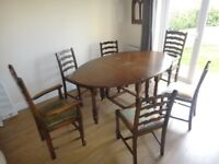 Oak gateleg dining room table with 6 chairs includes 2 leather seat carvers