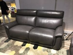Brand new Grey leather reclining loveseat