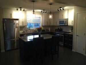 ROOM FOR RENT IN BRAND NEW COCHRANE HOME