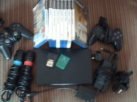 Playstation 2 & Microphones x2 / adaptor & 8 games .. 4 controllers + multitap ....