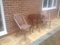 Plastic garden furniture with glass top