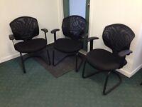 3 black mesh back visitors chairs