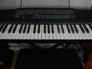 keyboard with bench and books for sale