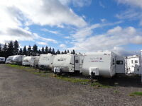PRE-OWNED  FIFTH WHEELS AND TRAVEL TRAILERS