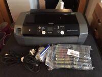 Epson Stylus Photo R240 Photo printer and bundle of cartridges.