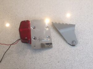Licence plate side mount with rear brake/running light