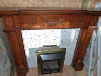 wooden fire surround , gas fire ,and marble hearth