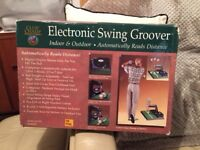 Electronic golf distance trainer